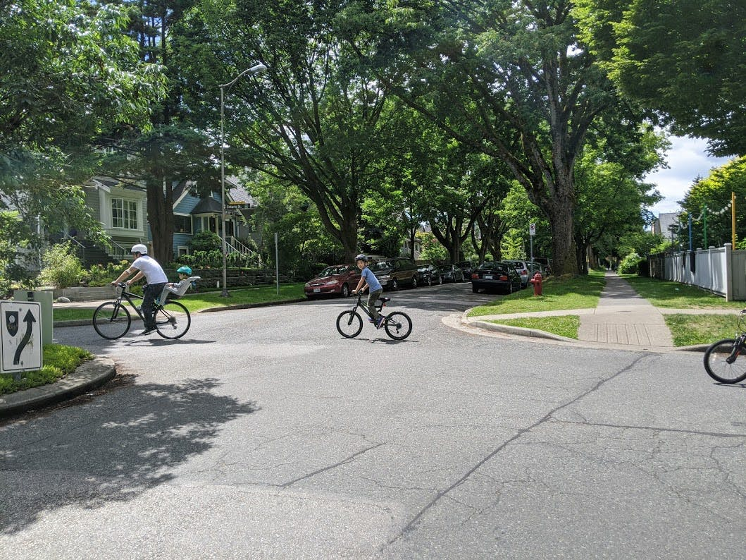 Slow Streets - 18th Ave at Ontario Greenway being used for safe and comfortable cycling by people of all ages.