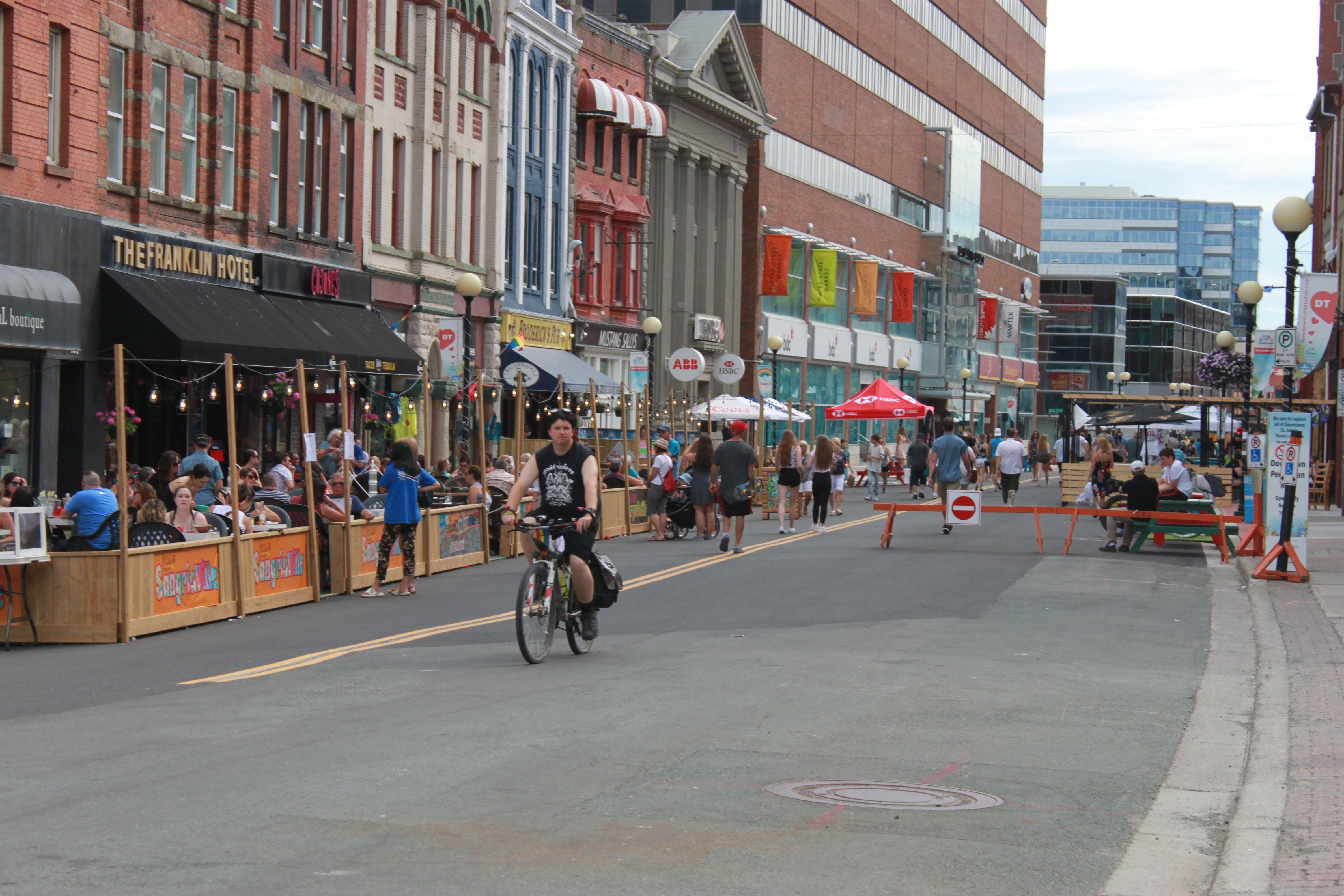 PIC_Water Street Pedestrian Mall_pedestrians restaurant patrons bicyclist.jpg