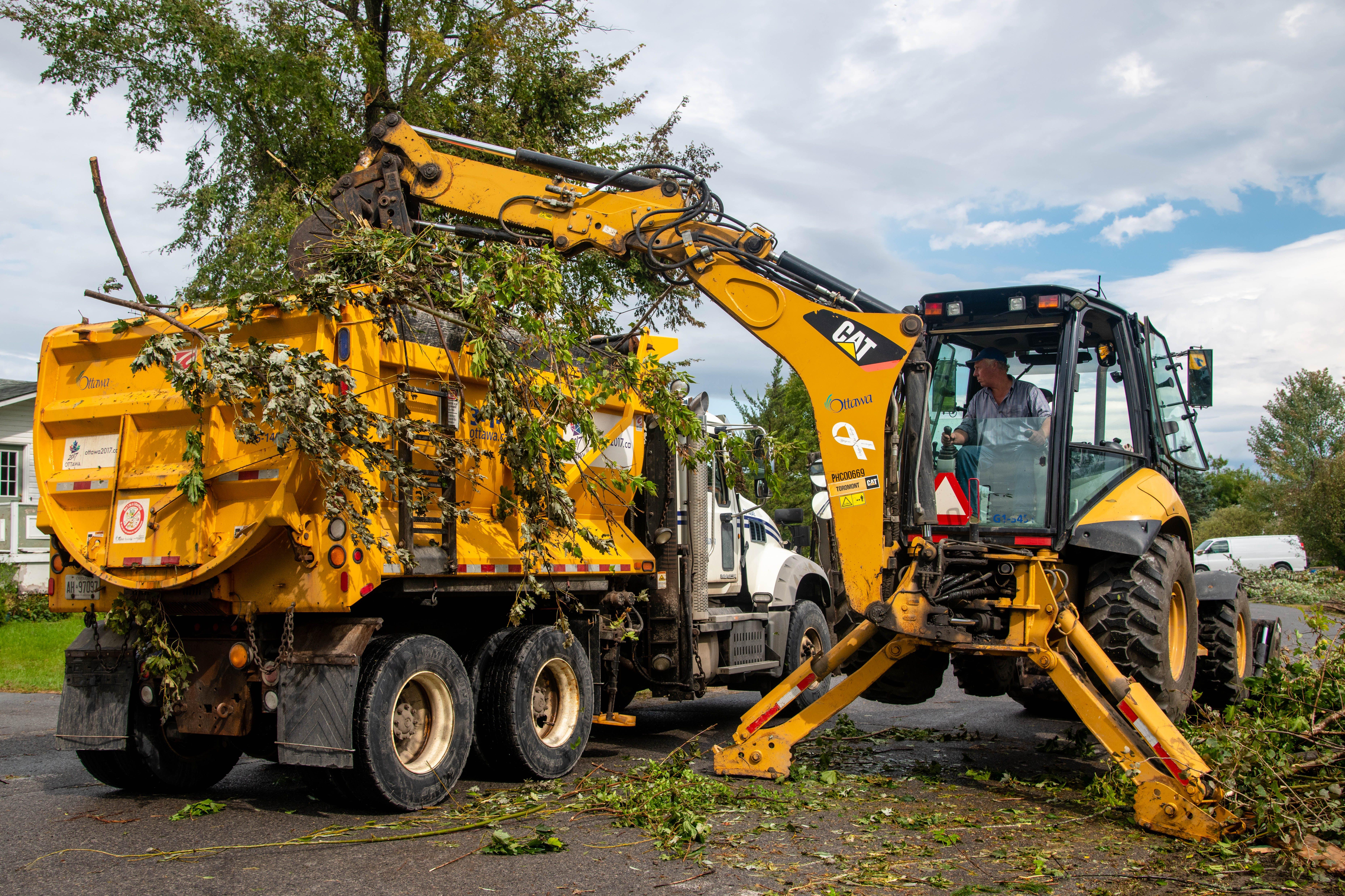 City machinery removing debris post tornado