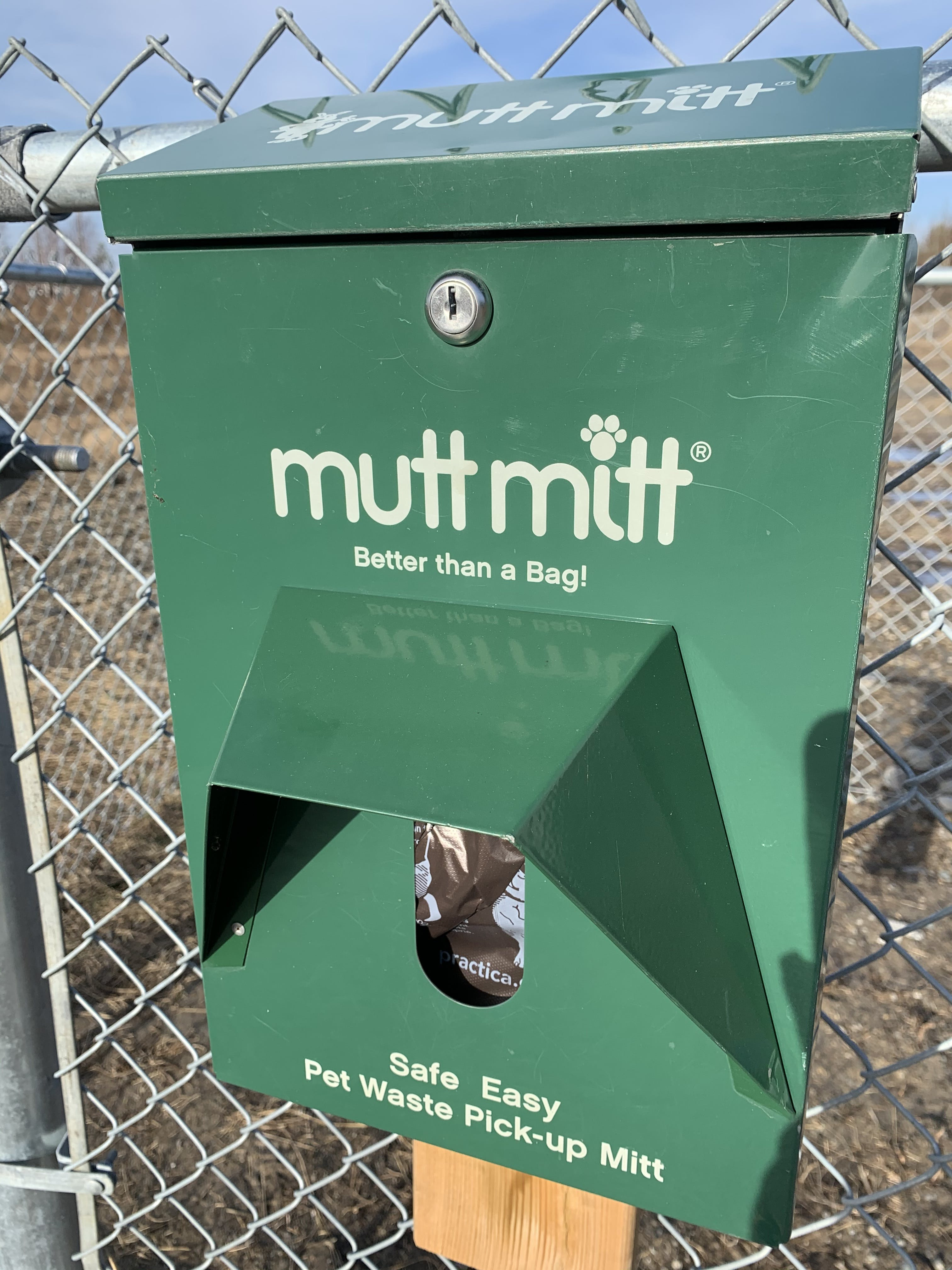 Mutt Mitt on big dog enclosure gate