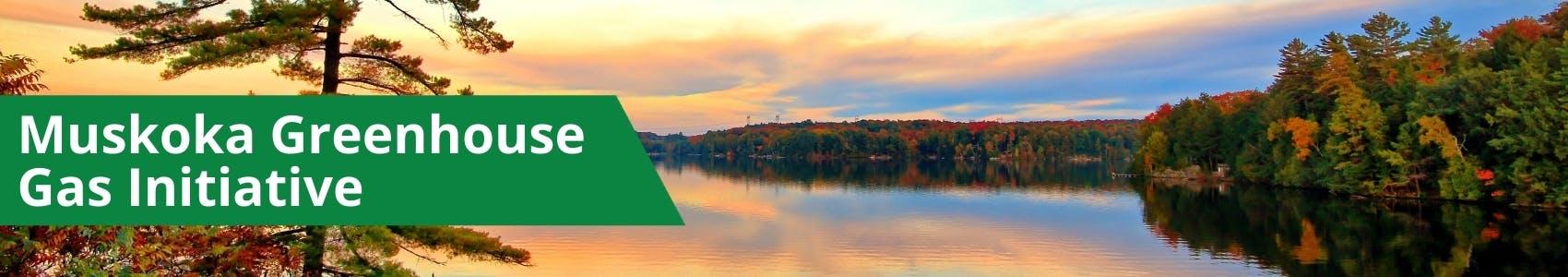 "A sunset photograph of a lake landscape within Muskoka. Banner reads ""Muskoka Greenhouse Gas Inventory"""