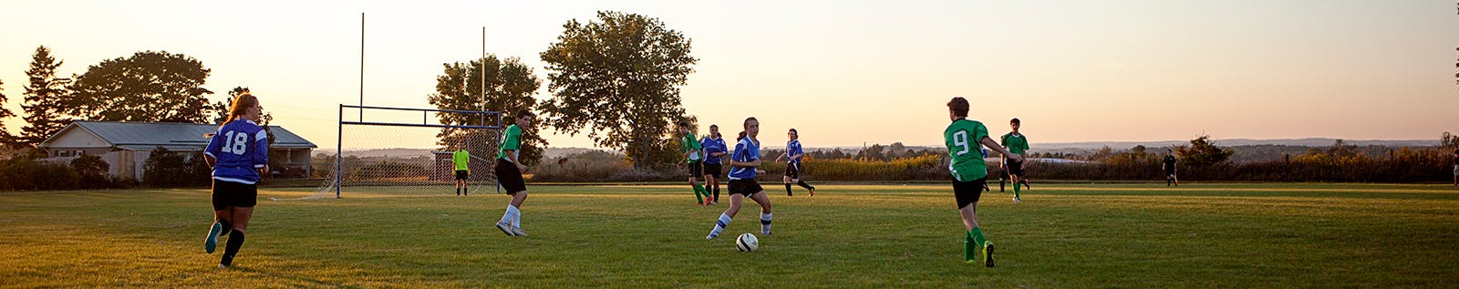 Youth play soccer on a Clarington field