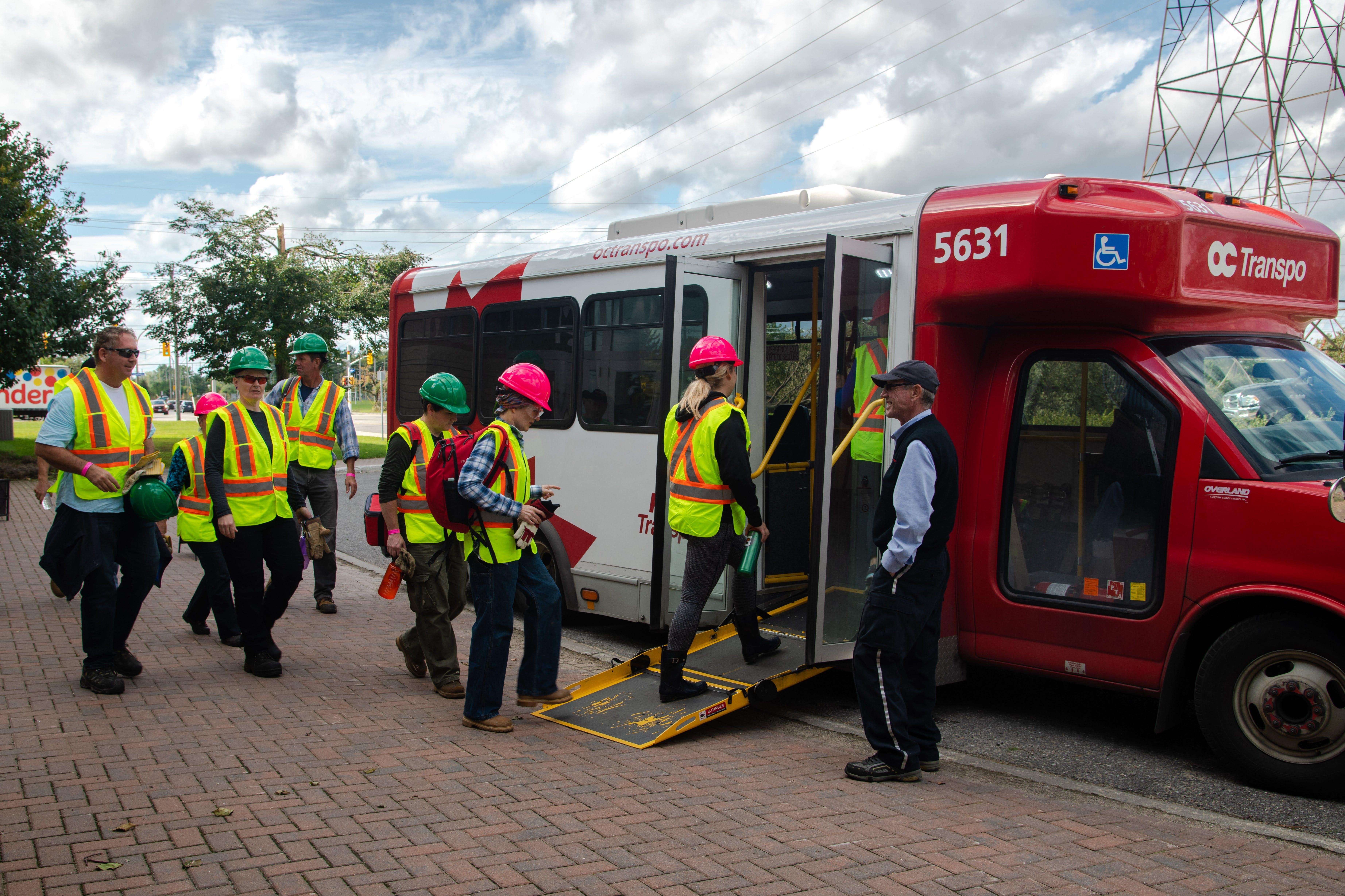 volunteers board the shuttle bus