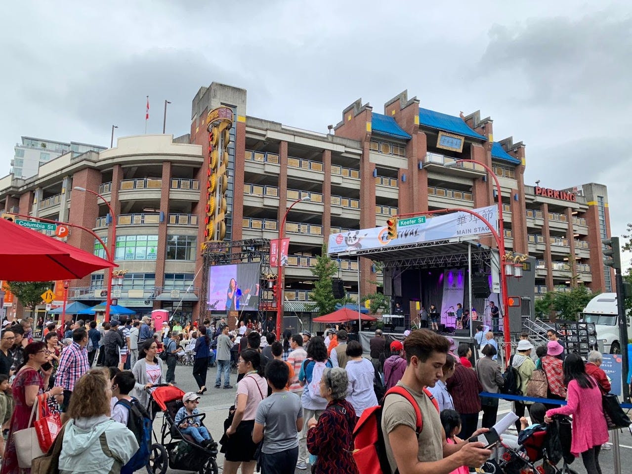 A large event with a stage for presentations is being held at Memorial Square.