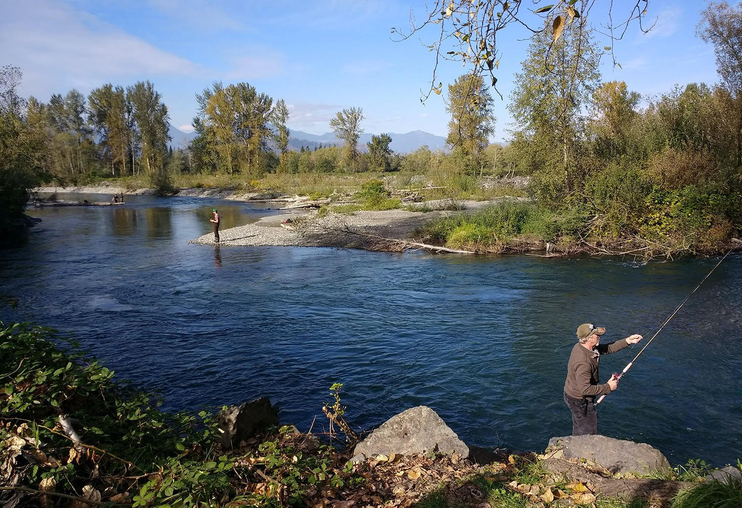 Two people fish in the Vedder River
