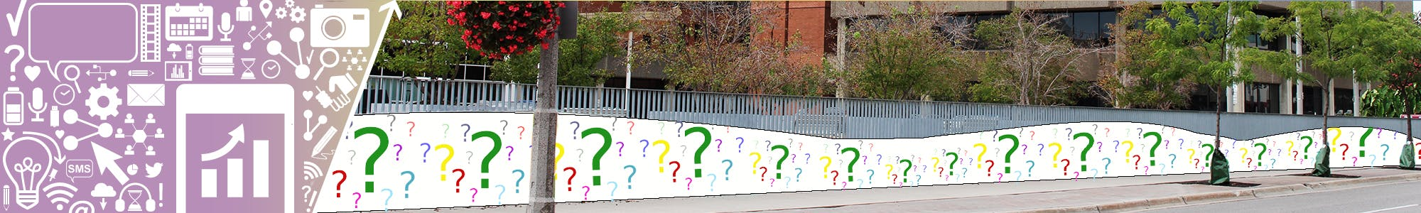 City Hall retaining wall with question marks where current mural is