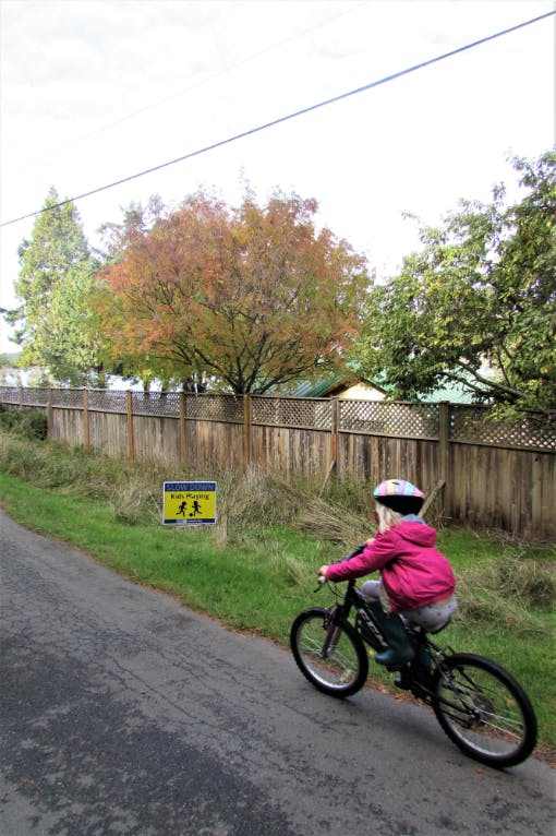 Child biking on road, Saturna Island