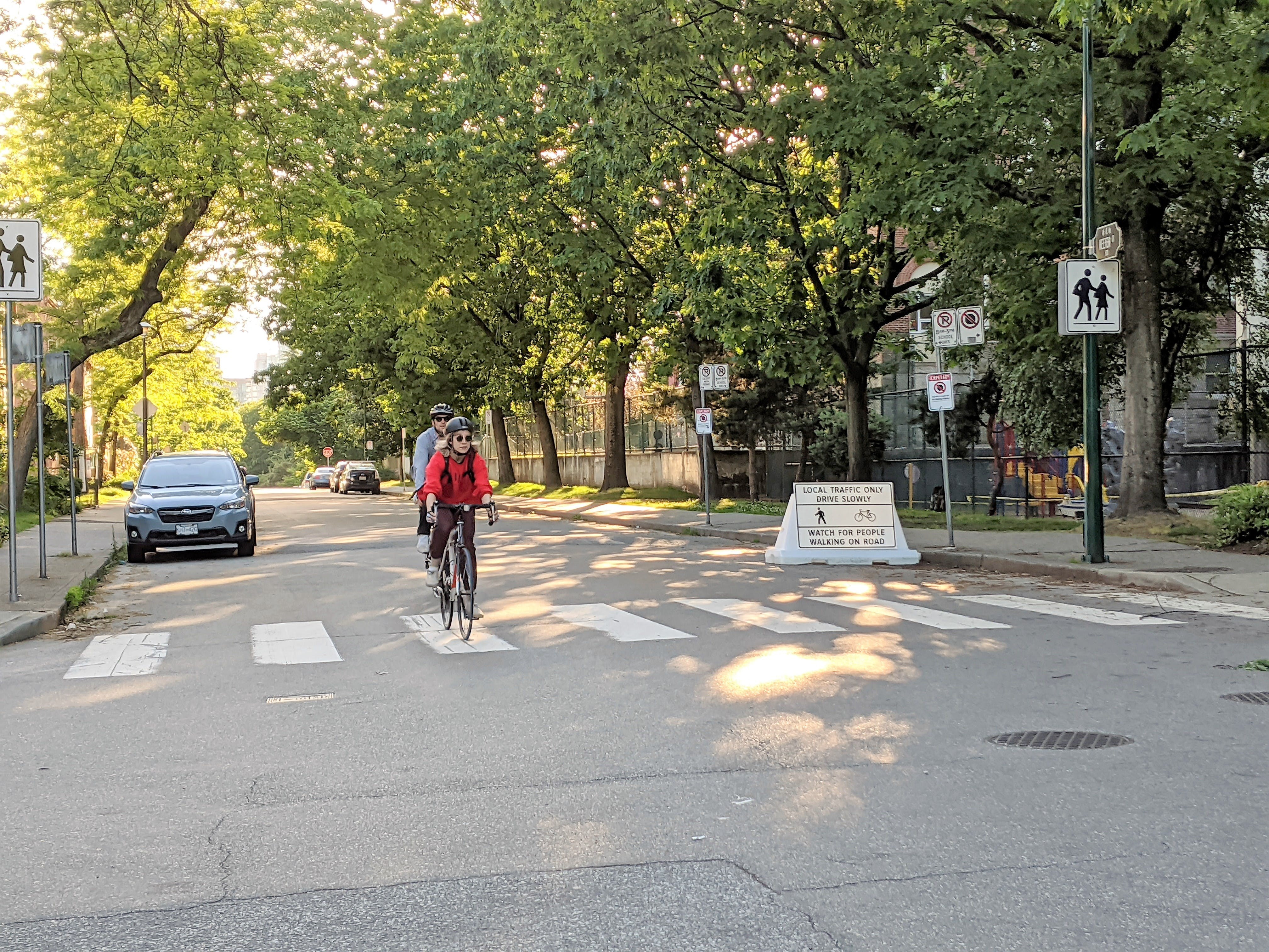 Two people cycling along Slow Streets - Keefer Street and Princess Ave