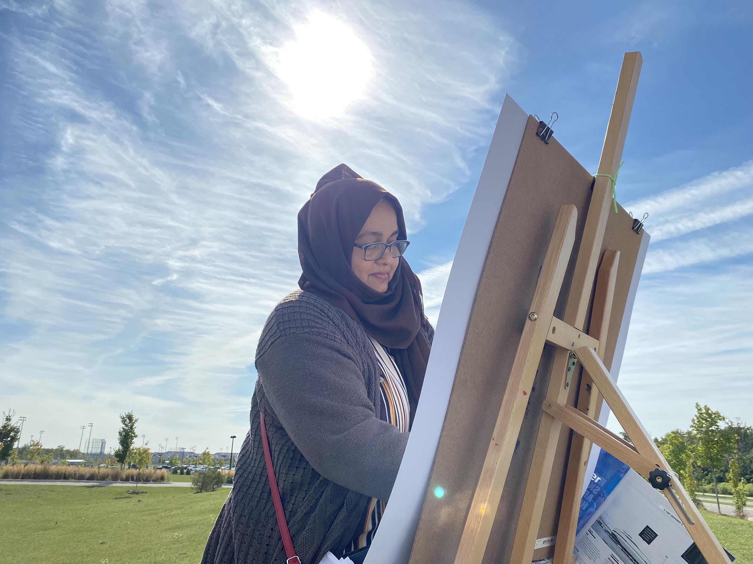 Nargis working at an easel.