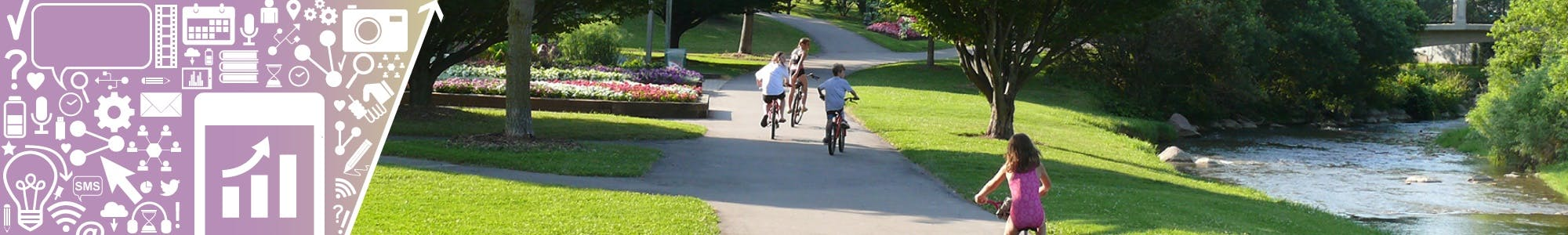 Children ride their bikes through an Oshawa park