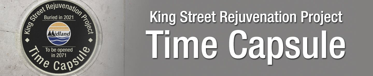 "A circular lid for a time capsule that says ""King Street Rejuvenation Project Time Capsule, Buried in 2021, To be opened in 2071."""