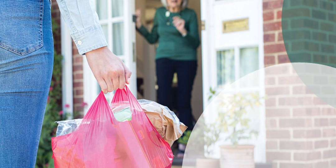 image of person dropping off groceries