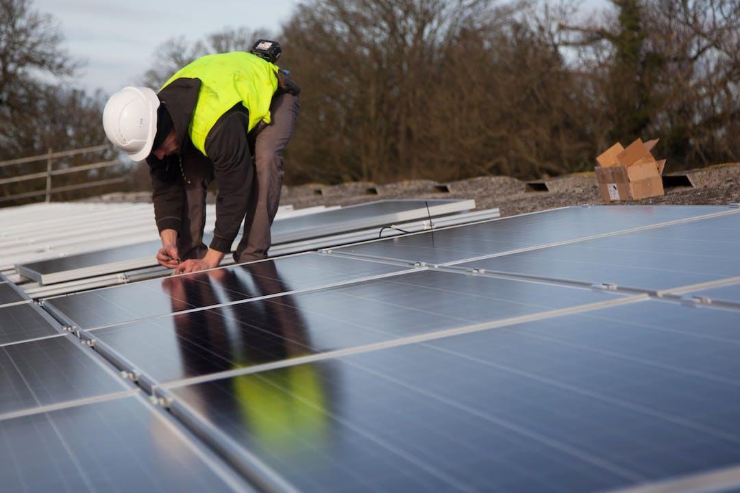 Builder installation roof top solar panels.