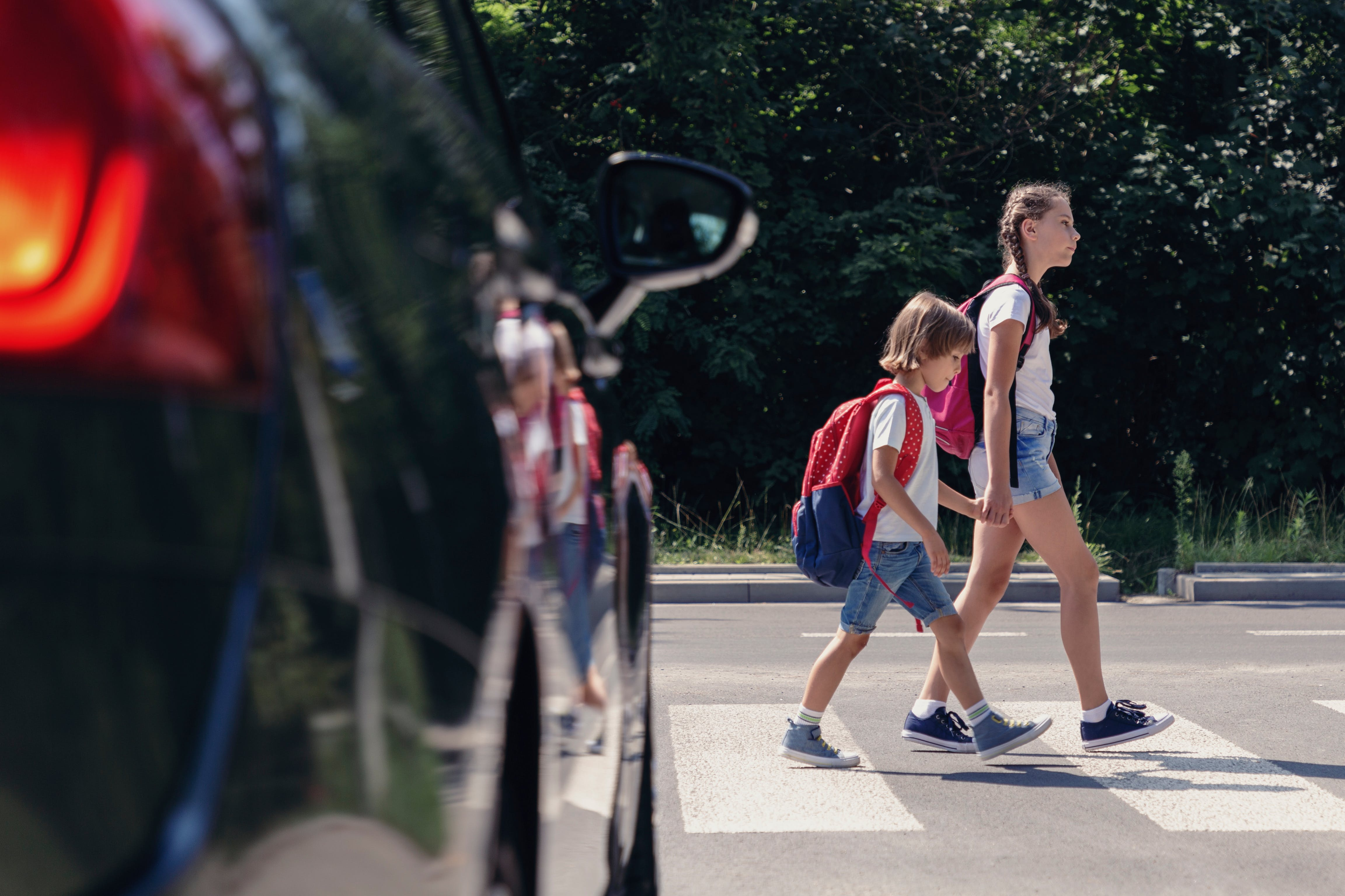 Kids crossing the road at a pedestrian crossing