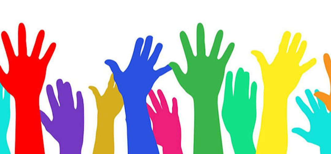 colourful hands in the air