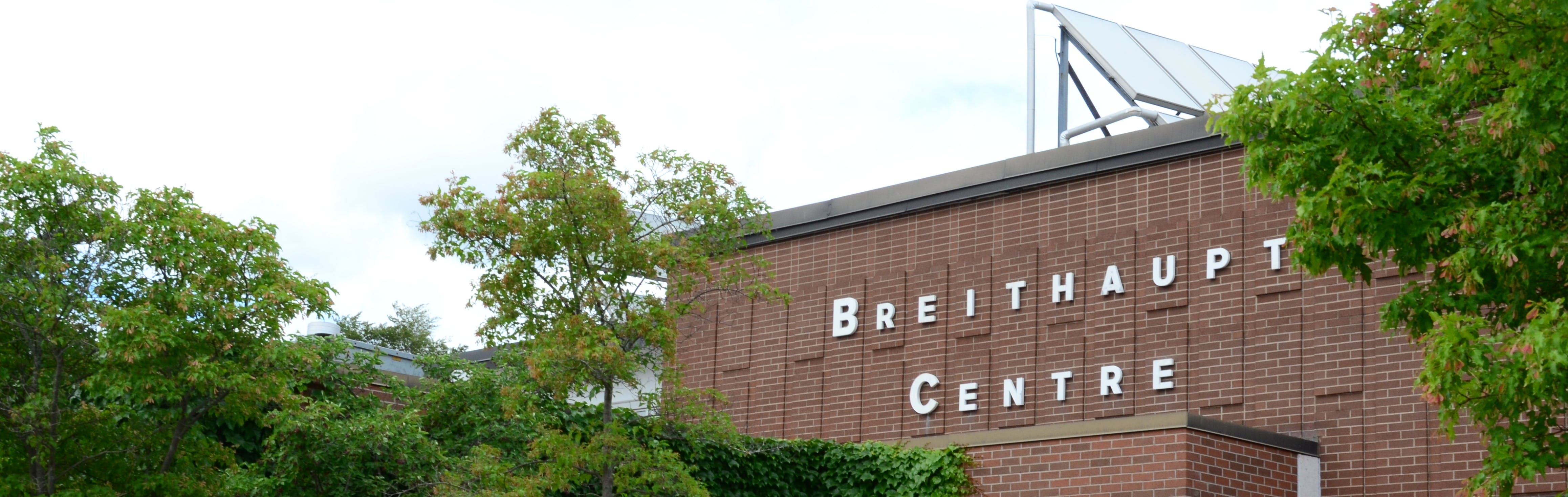 A photo of Breithaupt Community Centre on a summer day.