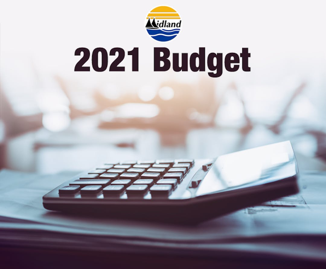 "An image of a calculator on a desk, with pieces of paper underneath. The words ""2021 Budget"" and the Town of Midland logo appear on the left side of the banner image."