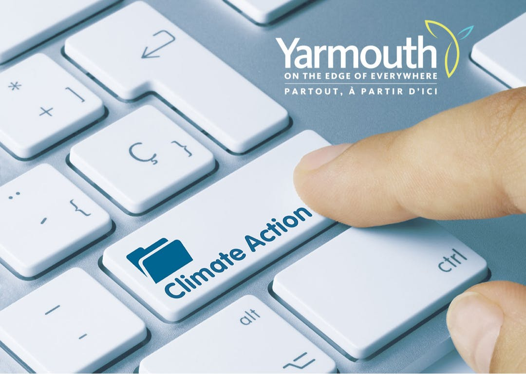 """Keyboard image with an enter button that says """"Climate Action"""" with a finger about to press it."""