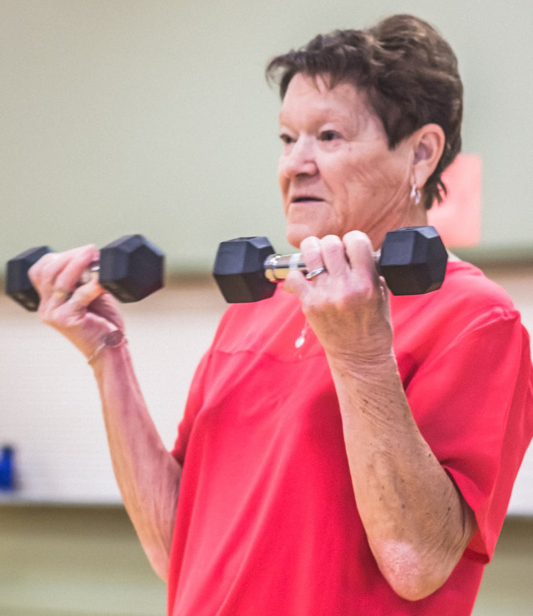 Lady with weights exercising