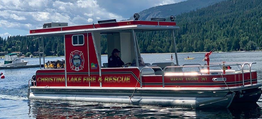 Christina Lake Fireboat leaves its mooring at the marina.