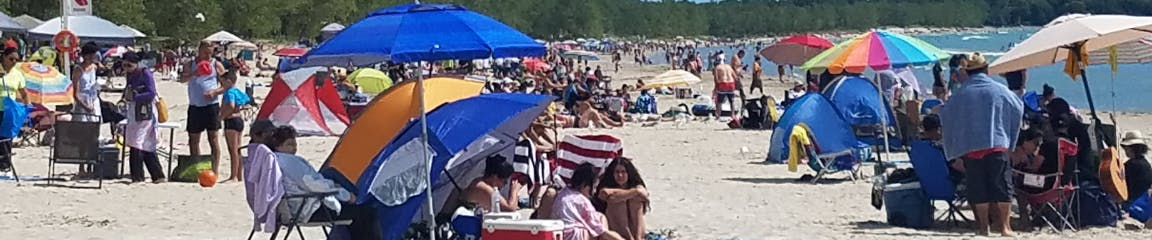 Image of a crowded beach at Sandbanks Provincial Park