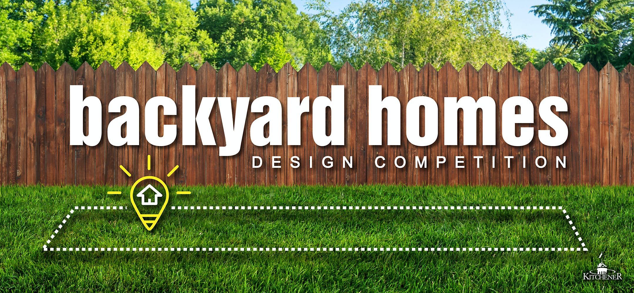A grassy backyard bordered by a wooden fence with the competition logo overlaid on top