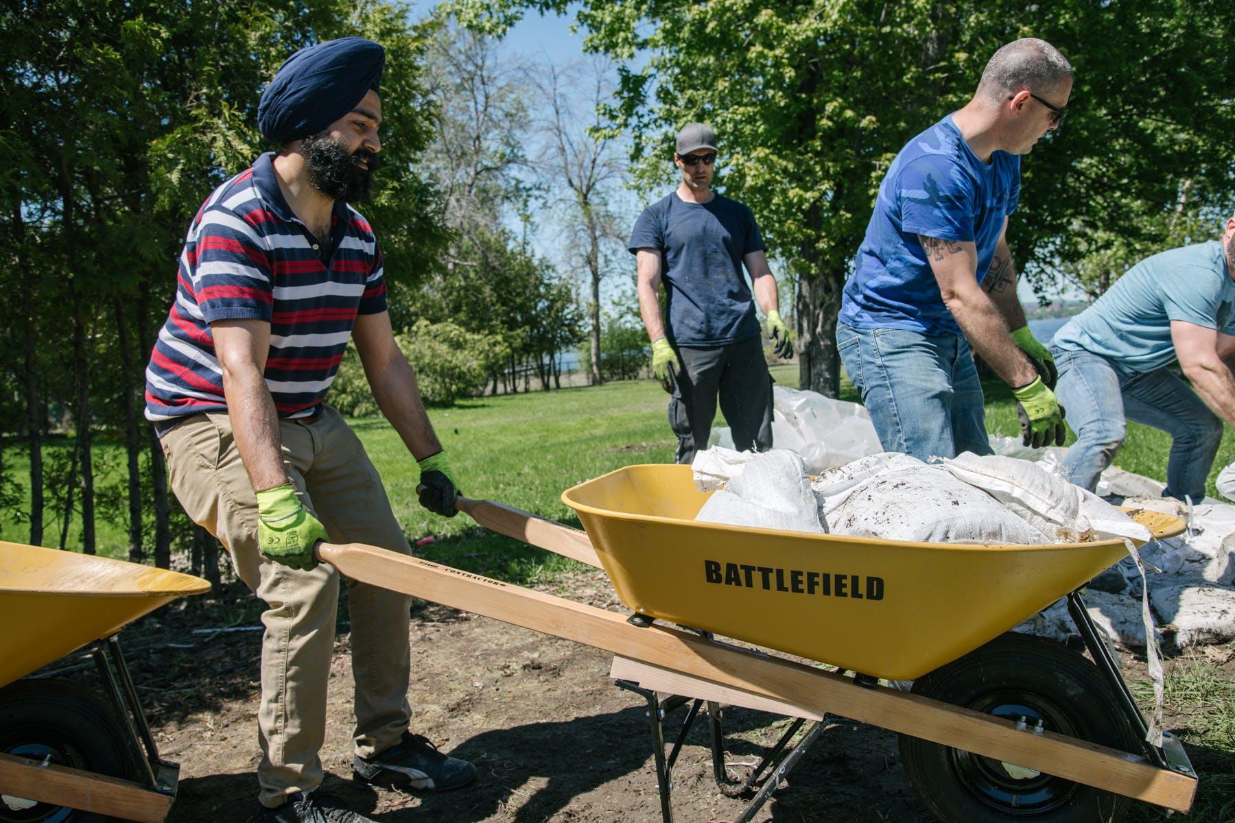 community volunteers move sandbags for flood relief