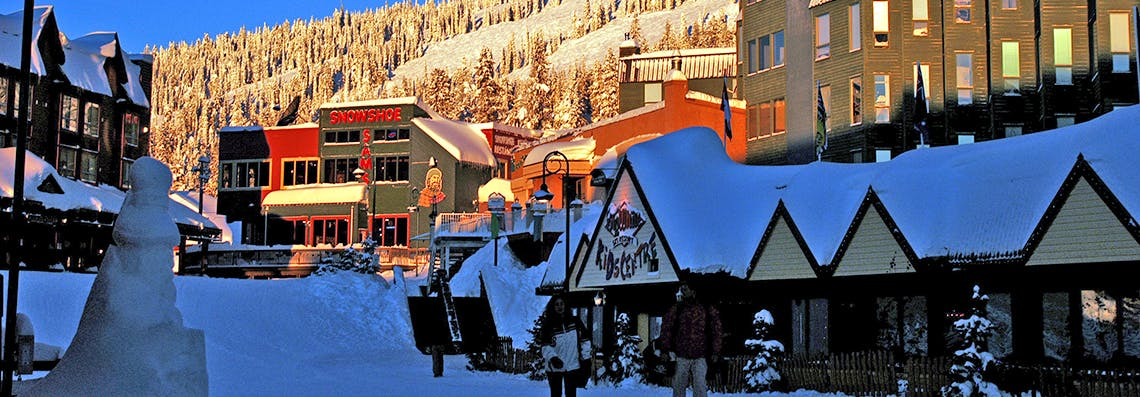 Big White Resort Village and people walking through centre of the community.
