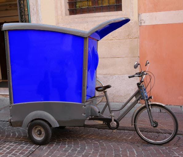A tricycle cargo e-bike design with enclosed cargo box at the back