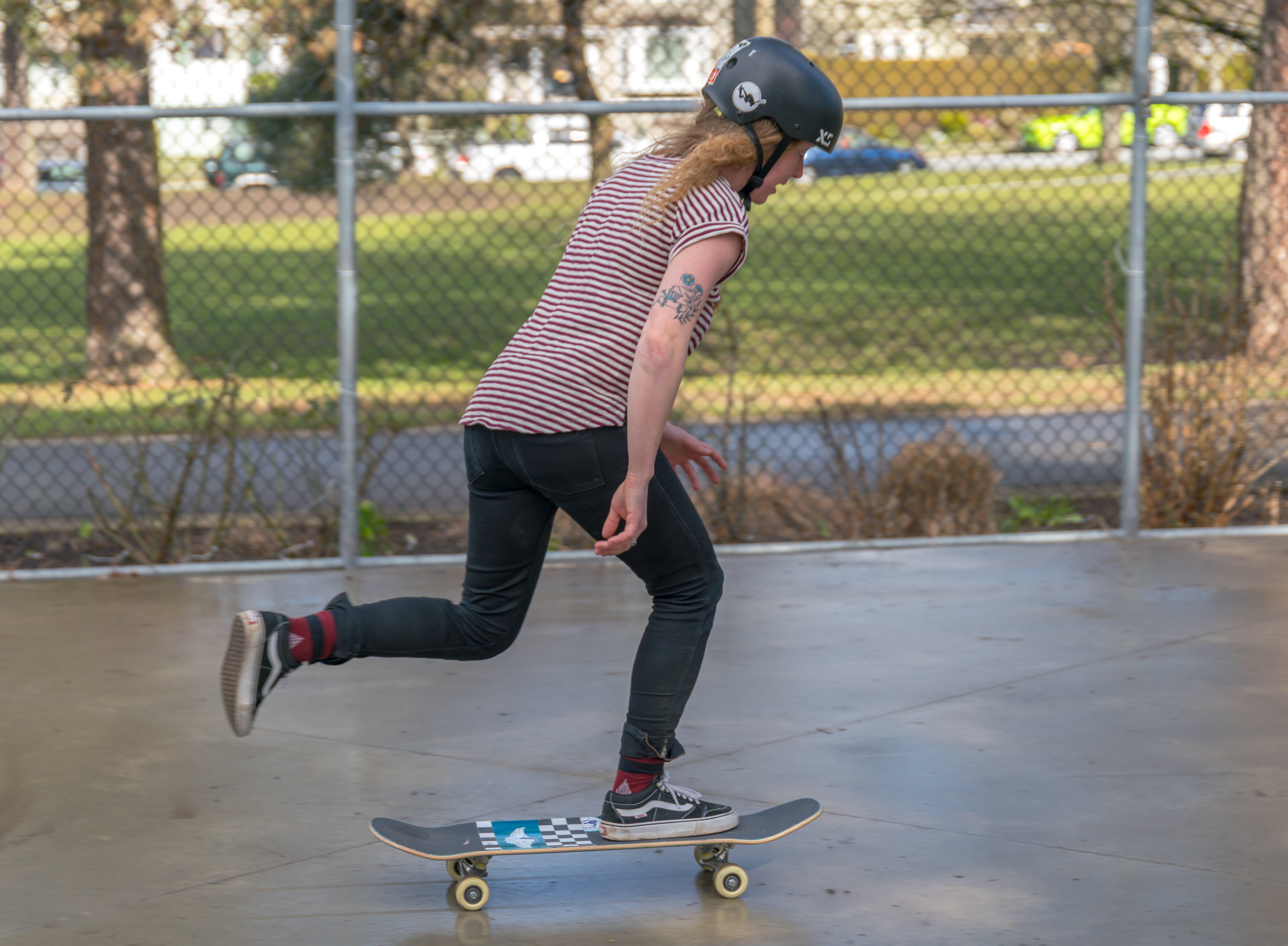 Adult woman skateboarding
