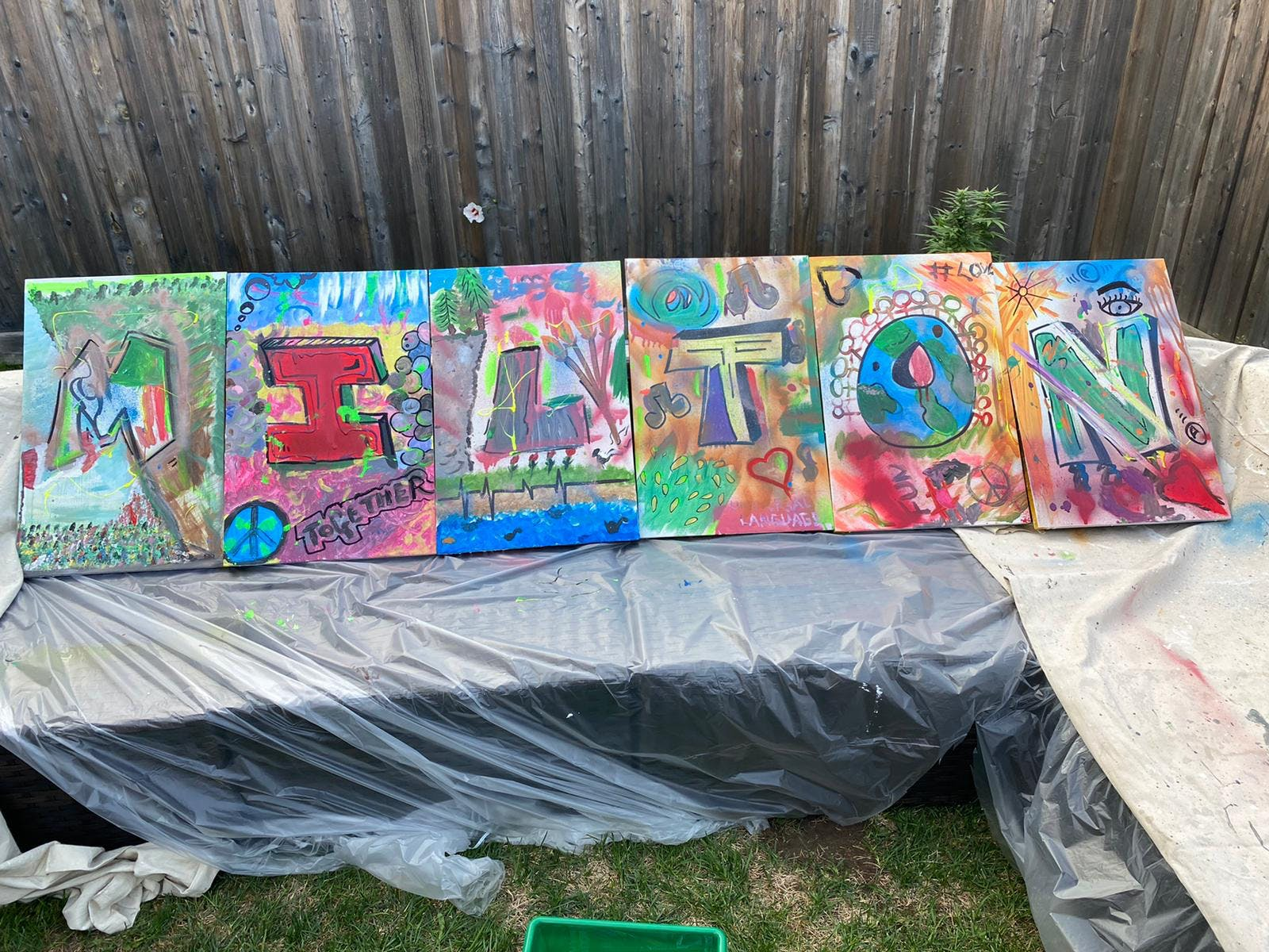 The word Milton painted on canvas.