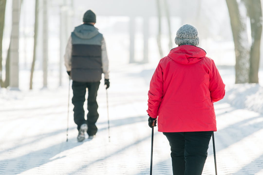 Two people walking on a snow-covered trail