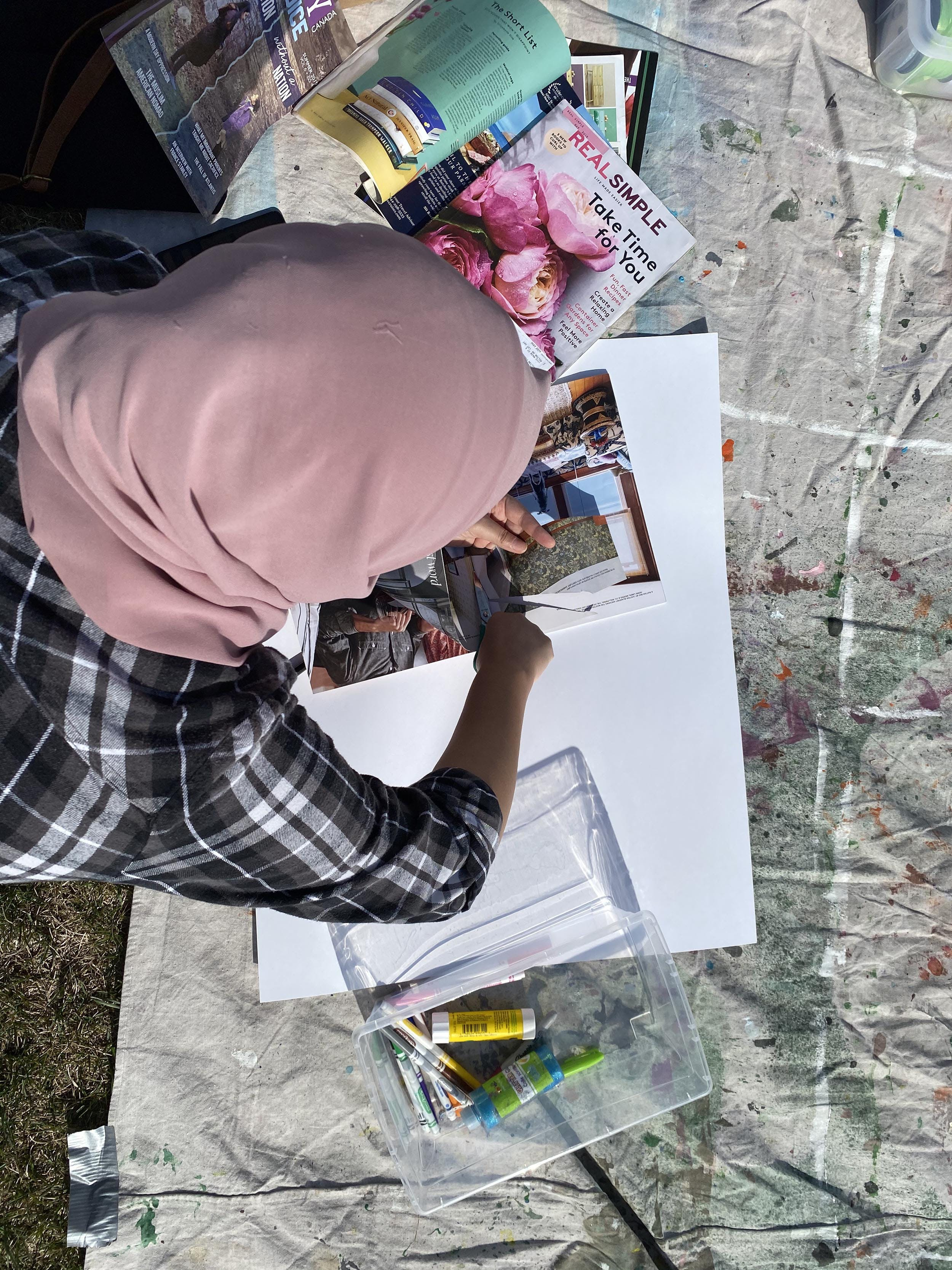 Saleha working on a collage.