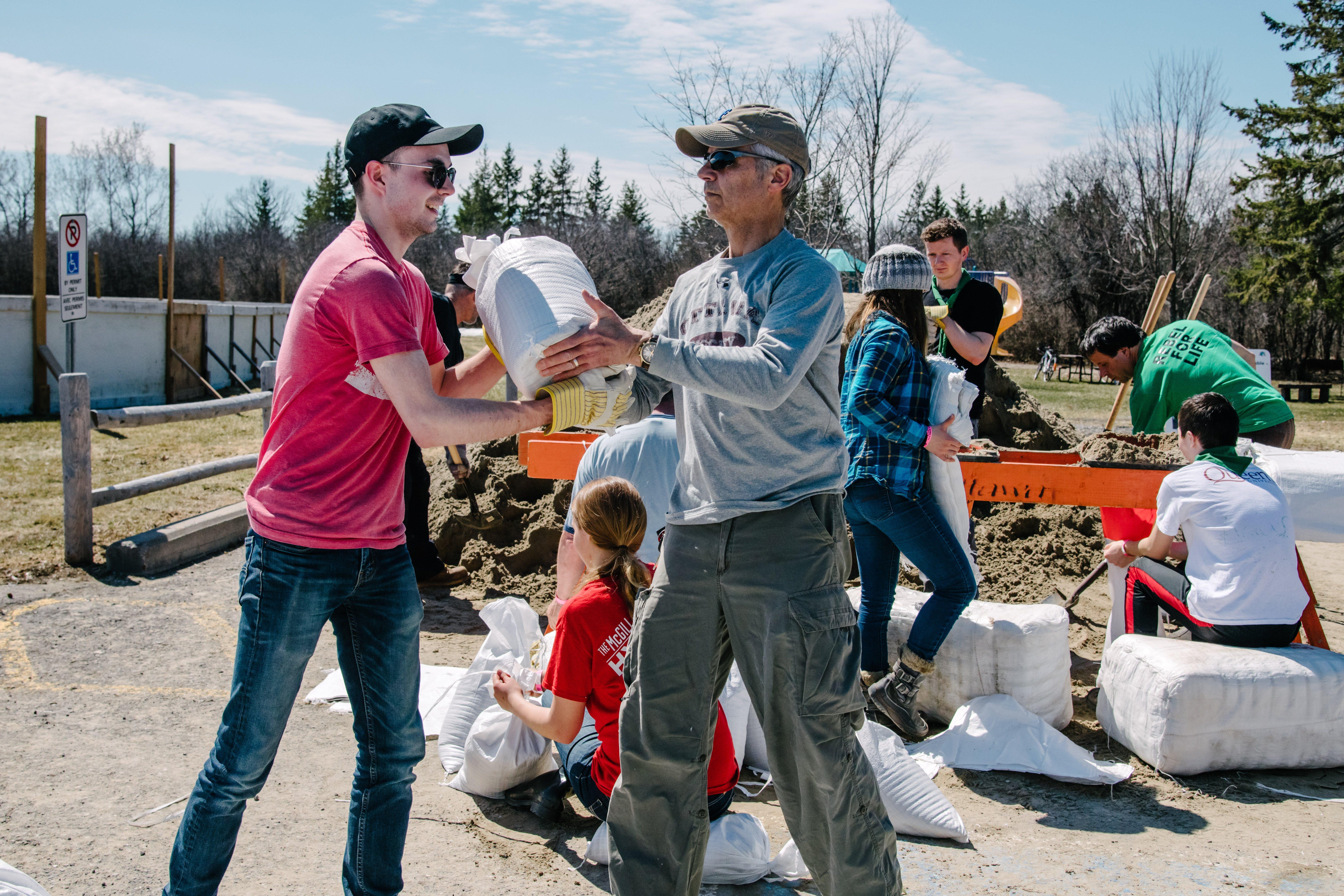 community volunteers filling and moving sandbags