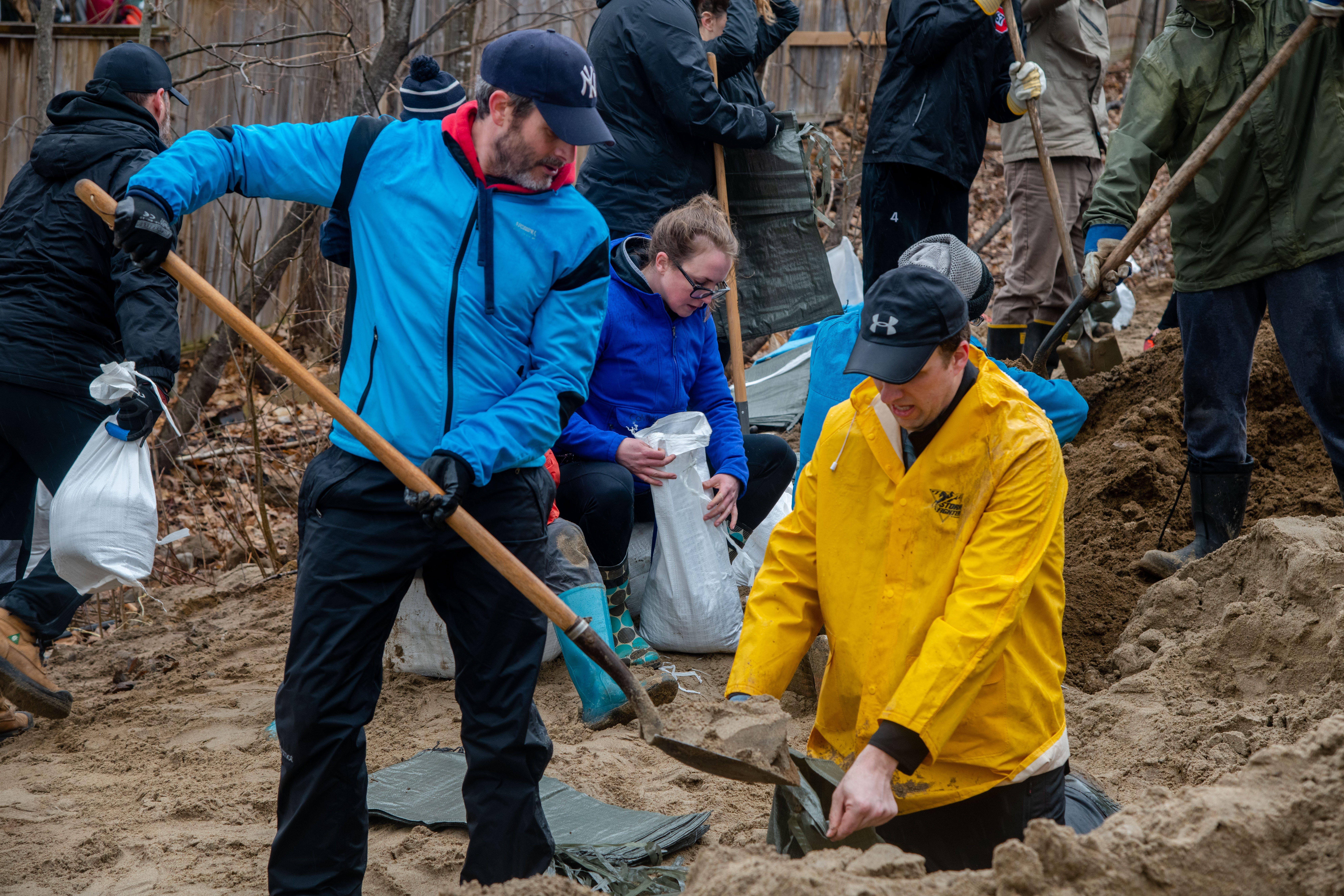 community volunteers filling sandbags
