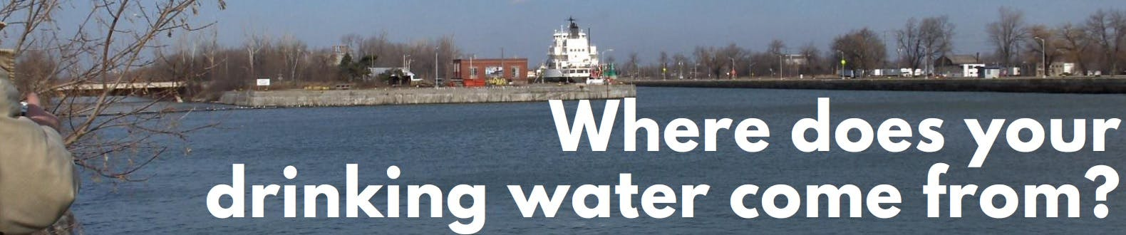 Where does your drinking water come from? Text on a banner for the project page showing a waterway, trees and a bridge.