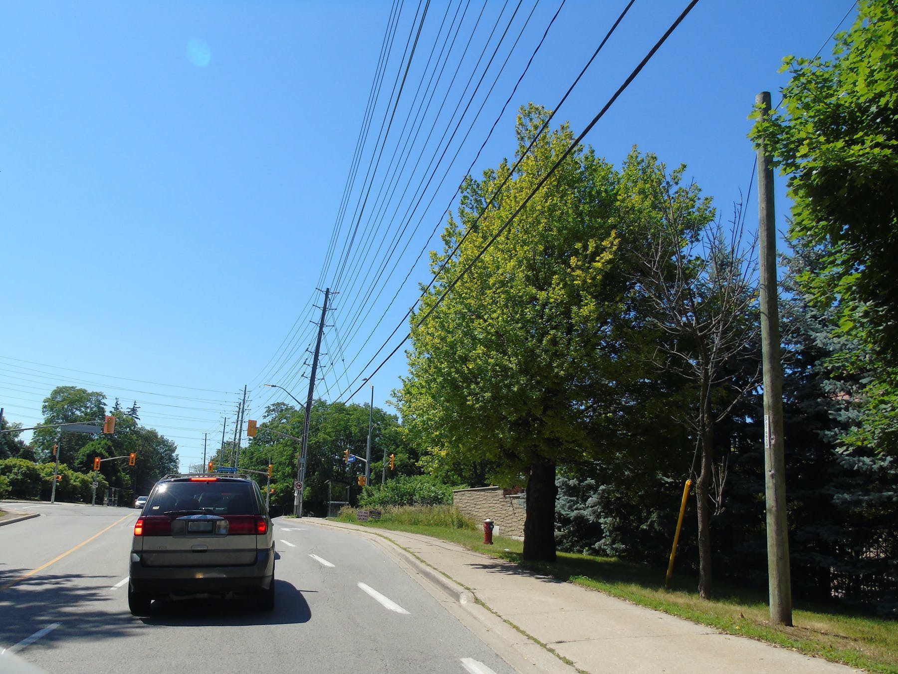 Scenic views and property fencing along Mississauga Road