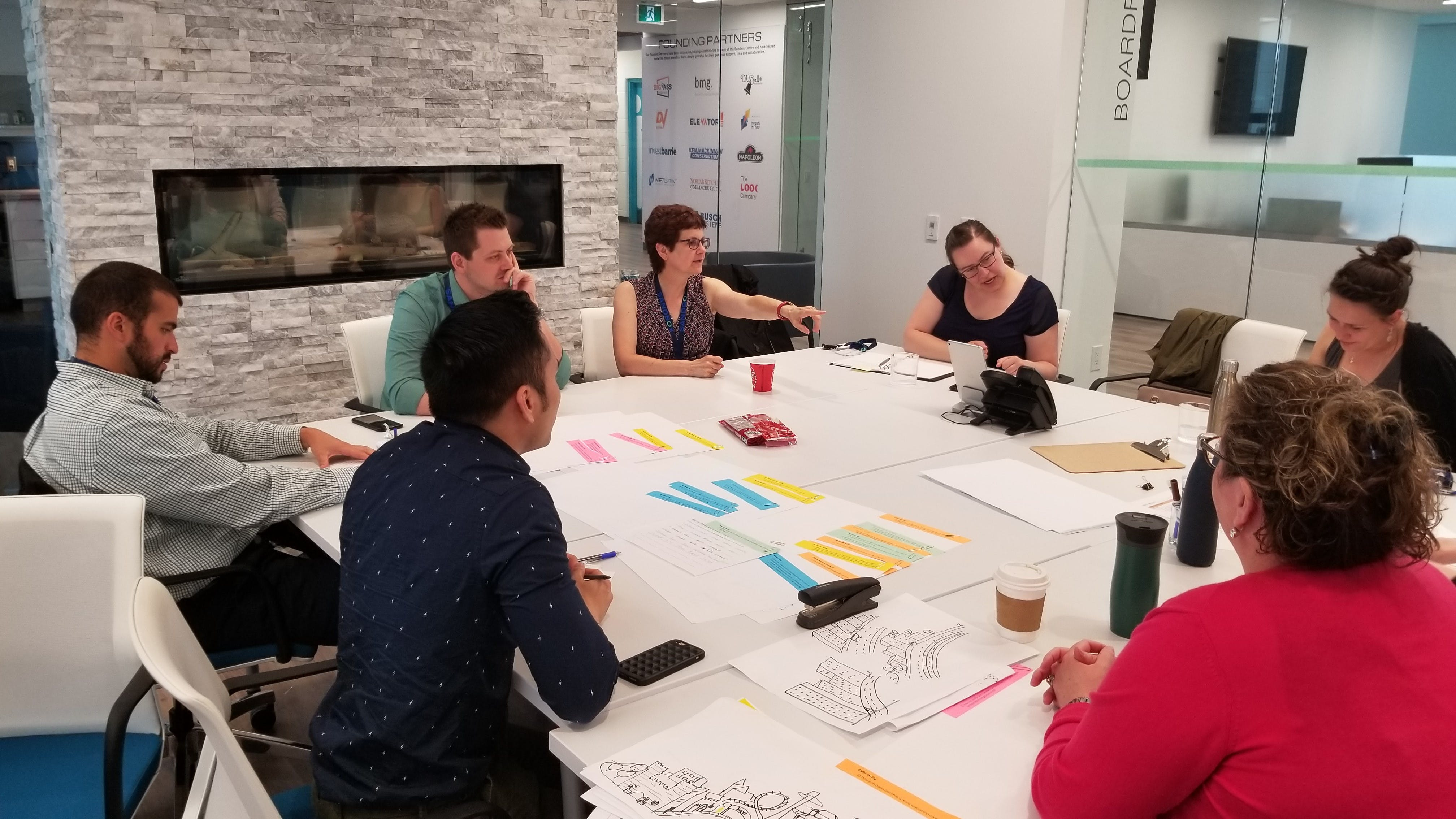 City planning staff working on policy development using ideas from the public feedback collected during Phase 2 consultations.