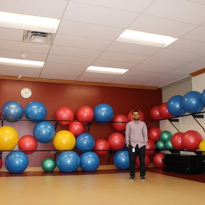 Hamid standing in the Civic Recreation Complex Aerobics Room under the new lighting system.