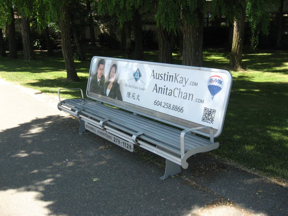 Privately-owned transit bench with advertising