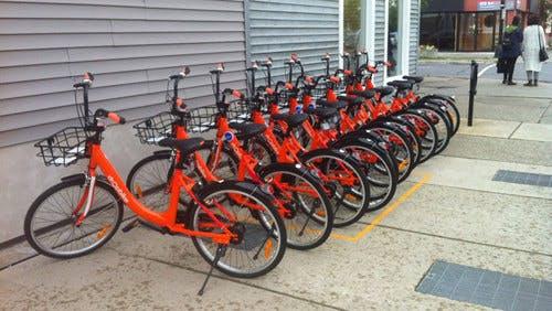 Row of Bikes along the sidewalk