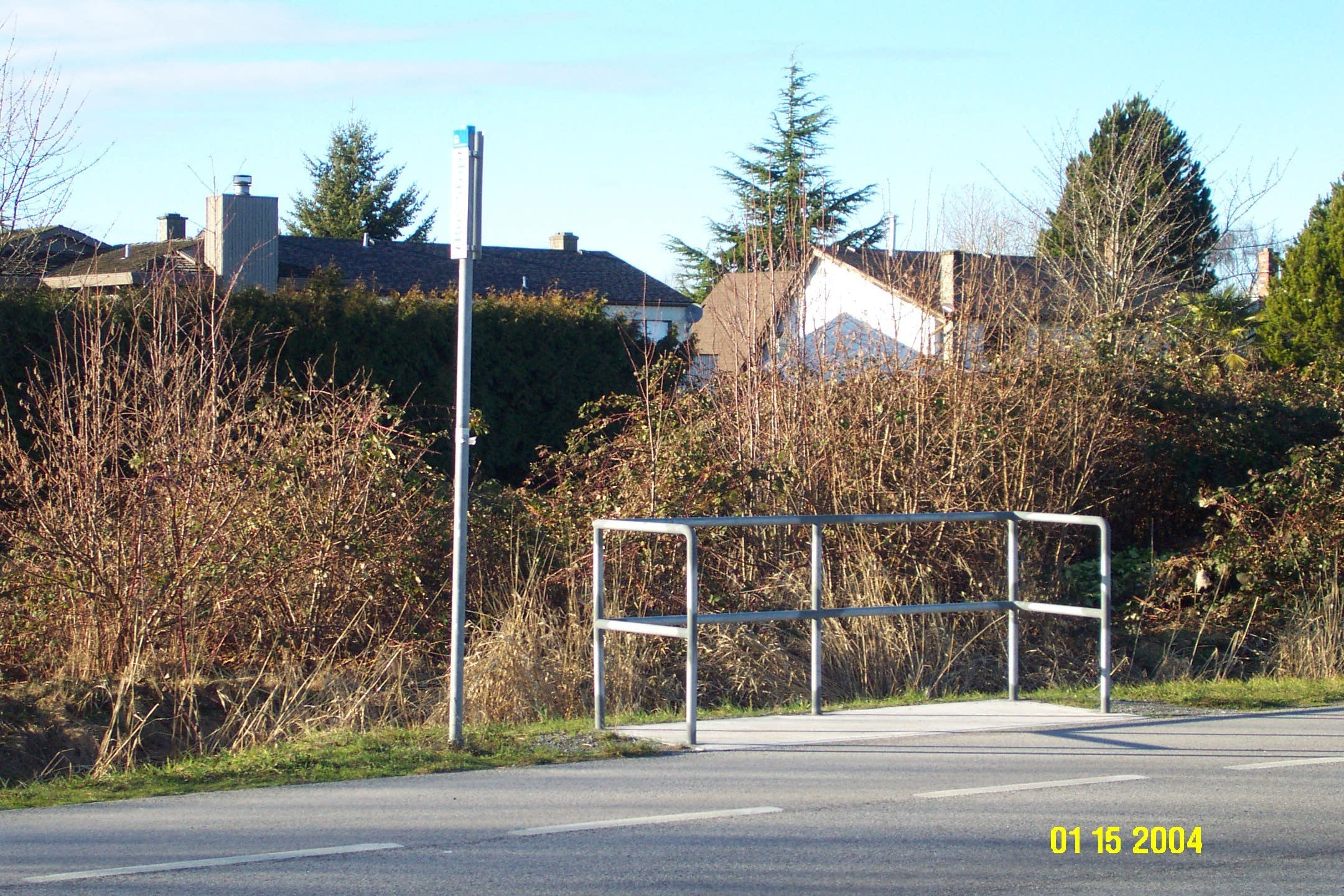 Non-accessible bus stop with no transit shelter