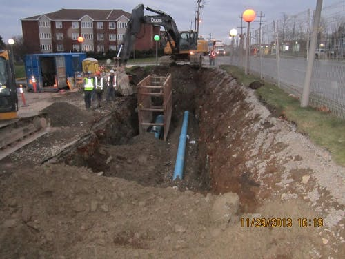 The photo shows a typical twin water main installation