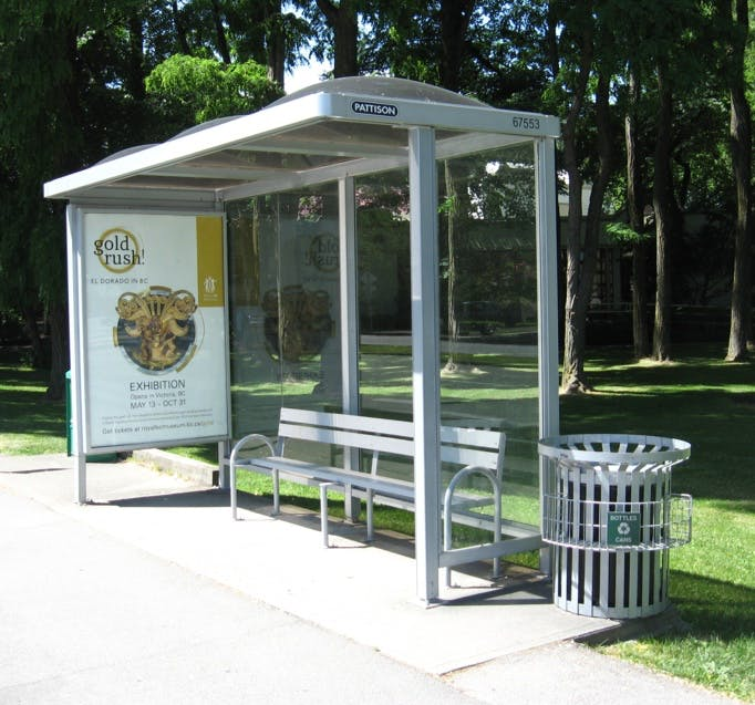 Privately-owned refurbished transit shelter with advertising
