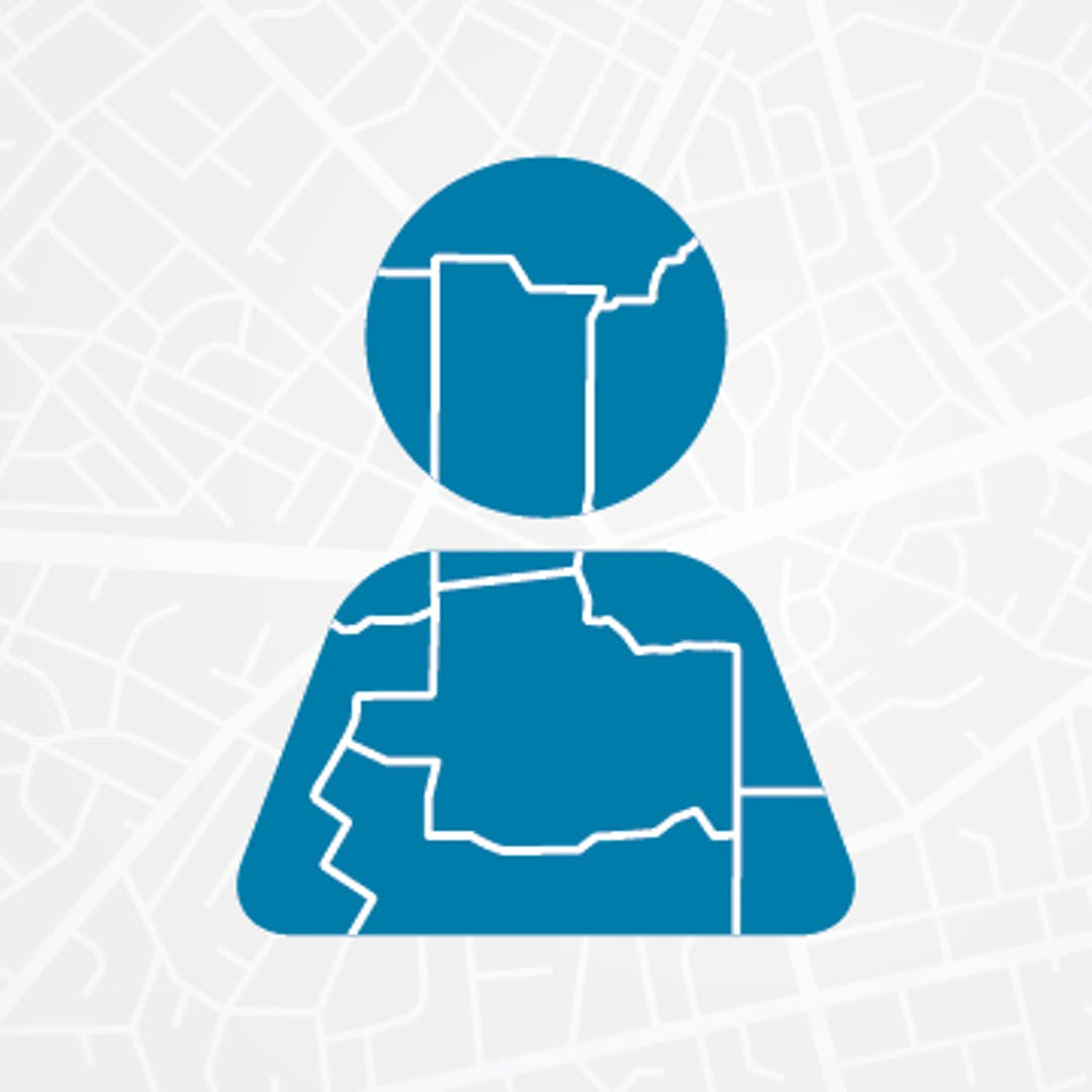Blue circle on top of blue quadrilateral, with white lines that imitate roads on a map covering both shapes. Both shapes together look look like a stylized image of a human. Background is light gray with lots of white lines imitating road map.