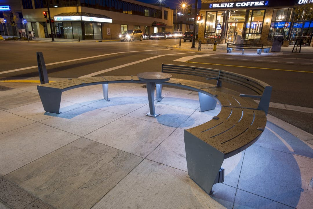 An example of streetscape elements (bench, table and bollard) installed on Bernard Avenue in downtown Kelowna.