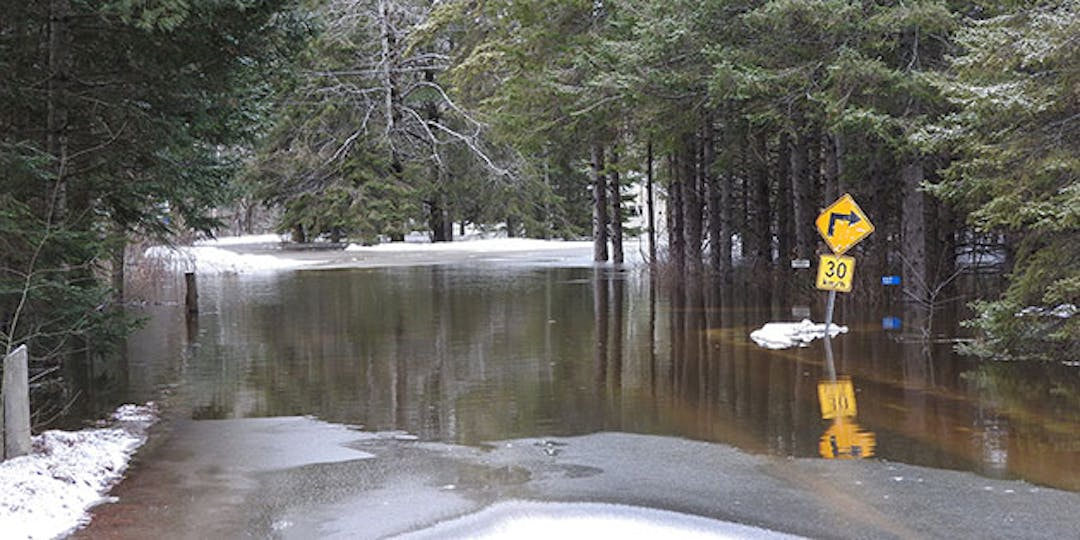 outdoor image of flooded road after ice and snow melt