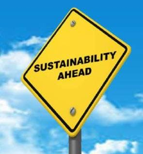 "Photo of yellow sign saying ""sustainability ahead"""