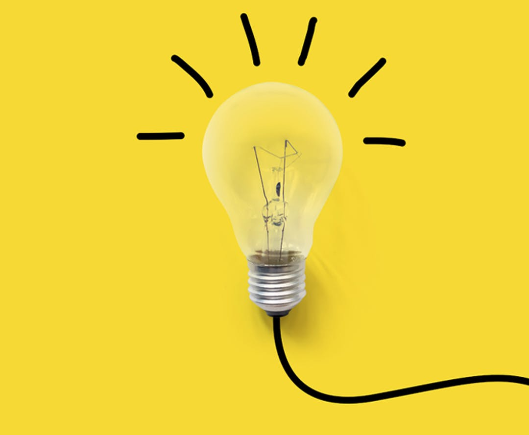 A light bulb with a electrical cord leading off the edge, bright yellow background.
