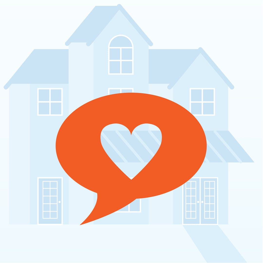 A speech bubble with a heart in the middle over top of an image of a heritage home.